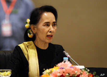 FILE - Myanmar's State Counsellor Aung San Suu Kyi speaks to members of the Union Peace Dialogue Joint Committee (UPDJC) on its ninth meeting at a hotel in Naypyitaw, Myanmar, Feb. 6. 2017. Suu Kyi and her administration made a peace process to end a...