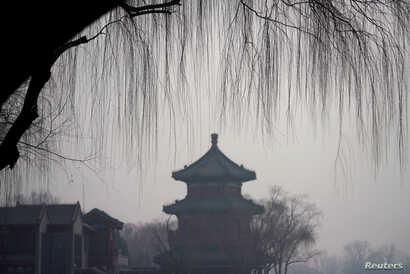 A traditional pavilion is seen amid smog in Beijing's Houhai area, China, Dec. 29, 2017.