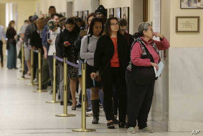 Voters line up at the Department of Elections at San Francisco's City Hall, June 7, 2016. California's changing demographics are aiding Democrats including Kamala Harris and Loretta Sanchez, competing for a U.S. Senate seat in November's election.ing...
