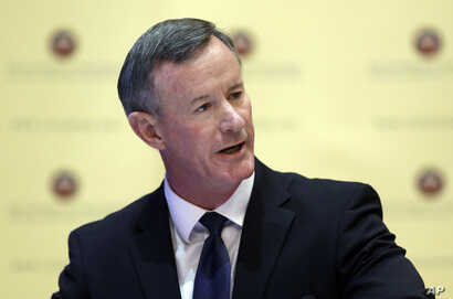 FILE - U.S. Navy Adm. William McRaven addresses the Texas Board of Regents, in Austin, Texas, Aug. 21, 2014.