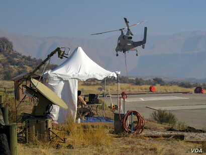 Two controllers on the group put the K-MAX unmanned chopper through its paces. (Credit: Tom Banse)