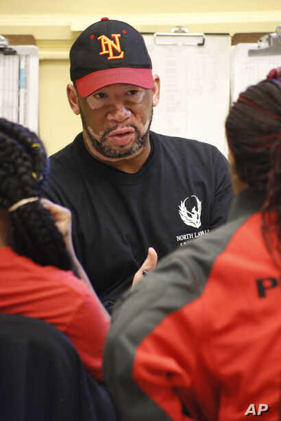 Gerald Smith, student advocate and dean of restorative justice at Chicago's North Lawndale College Prep High School, speaks to students about their disagreement with a teacher, April 19, 2018. Smith also serves as the adult adviser for the school's P...
