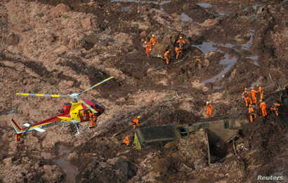 Rescue crew work in a tailings dam owned by Brazilian miner Vale SA that burst, in Brumadinho, Brazil Jan. 25, 2019.