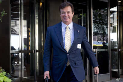 FILE - Paul Manafort , senior aid to Republican Presidential candidate Donald Trump leaves the Four Seasons hotel in New York, after a GOP fundraiser.