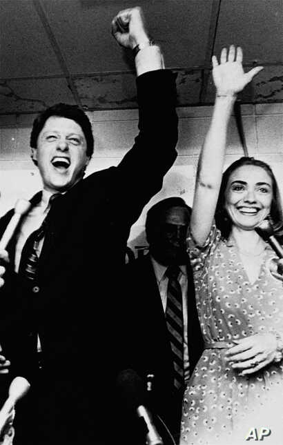 Former Arkansas Gov. Bill Clinton and his wife Hillary celebrate his victory in the Democratic runoff in Little Rock, Ark. in this June 8, 1982 file photo. The Arkansas years, with Bill Clinton serving first as state attorney general, and later as go