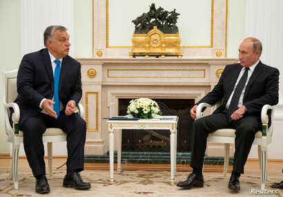 Hungarian Prime Minister Viktor Orban speaks with Russian President Vladimir Putin during their meeting at the Kremlin in Moscow, Sept. 18, 2018.