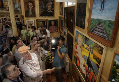 FILE - Russian poet Yegeny Yevtushenko, second left, is seen at the opening of his museum in Peredelkino, outside Moscow, July 17, 2010. Over a hundred paintings, including works by Pablo Picasso and Marc Chagall, and pictures made by the poet were o...