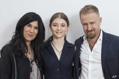 "FILE -Director Debra Granik, left, poses with actors Thomasin McKenzie, center, and Ben Foster for the film ""Leave No Trace,"" at the 71st international film festival, Cannes, southern France, May 14, 2018."