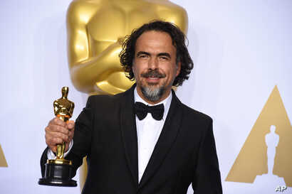 "Alejandro G. Inarritu poses in the press room with the award for best director for ""The Revenant"" at the Oscars on Feb. 28, 2016, at the Dolby Theatre in Los Angeles."
