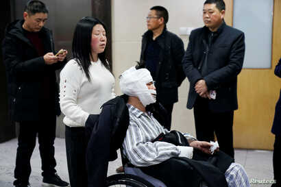 Worker Hu is seen bandaged at a hospital after he was injured following an explosion at a pesticide plant owned by Tianjiayi Chemical in Yancheng, Jiangsu province, China, March 24, 2019.