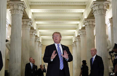 President Donald Trump speaks in the Hall of Columns as he arrives on Capitol Hill in Washington, Tuesday, June 19, 2018, to rally Republicans around a GOP immigration bill.