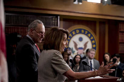 House Speaker Nancy Pelosi of Calif., accompanied by Senate Minority Leader Sen. Chuck Schumer of N.Y., left, speaks at a news conference on Capitol Hill in Washington, Jan. 25, 2019, after President Donald Trump announces a deal to reopen the govern