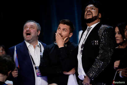Russia's Sergey Lazarev (C) reacts during the final vote counting during the Eurovision Song Contest final at the Ericsson Globe Arena in Stockholm, Sweden, May 14, 2016.