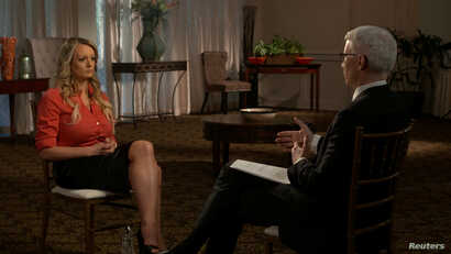 "Stormy Daniels, an adult film star and director whose real name is Stephanie Clifford, is interviewed by Anderson Cooper of CBS News' ""60 Minutes"" program in early March 2018, in a still image from video provided March 25, 2018."