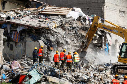 Emergency personnel work at the scene after a building collapsed in a residential area of Nairobi, Kenya, June 13, 2017.