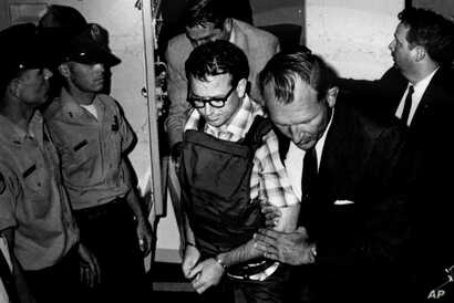 James Earl Ray is being transported in Memphis, Tennessee this 1968 photo released by the Shelby County Register's office on March 31, 2011.