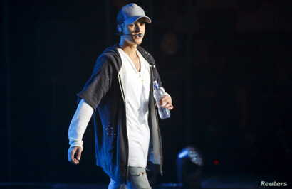Singer Justin Bieber walks on stage during a concert in Oslo Oct. 29, 2015.