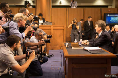 Supreme Court nominee Brett Kavanaugh faces photographers as he prepares to testify during the third day of his confirmation hearing before the Senate Judiciary Committee on Capitol Hill in Washington, Sept. 6, 2018.