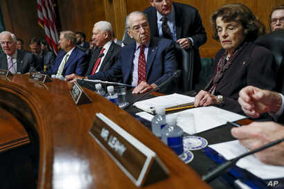 From left, Senate Majority Whip Sen. John Cornyn, R-Texas, Sen. Lindsey Graham, R-S.C., Sen. Orrin Hatch, R-Utah, Senate Judiciary Committee Chairman Chuck Grassley of Iowa, and Ranking Member Sen. Dianne Feinstein, D-Calif., gather before a Senate J...