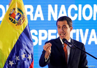Venezuelan opposition leader Juan Guaido, who many nations have recognized as the country's rightful interim ruler, speaks during a meeting with representatives of the oil sector in Caracas, Venezuela, Feb. 5, 2019.