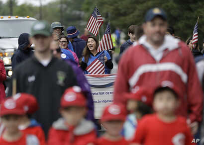FILE - Christine Lui Chen, center, who is running for state senate, participates in the Bridgewater Memorial Day Parade in Bridgewater, N.J., May 29, 2017.