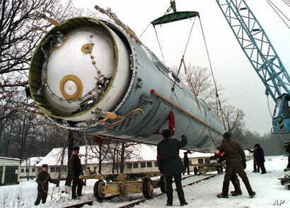 FILE - Soldiers prepare to destroy a ballistic SS-19 missile in the yard of the largest former Soviet military rocket base in Vakulenchuk, Ukraine, Dec. 24, 1997. Trump administration officials say the U.S. sees value in the New START arms control a...