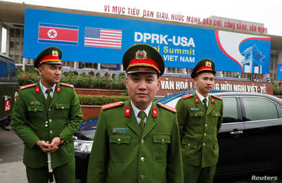 Vietnamese police officers stand guard outside the North Korea-U.S. summit's media center in Hanoi, Vietnam, Feb. 23, 2019.