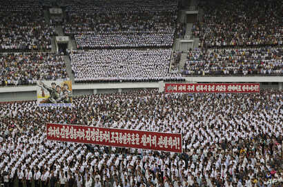 """FILE - North Koreans gather at the """"Pyongyang Mass Rally on the Day of the Struggle Against the U.S."""" to mark the 65th anniversary of the outbreak of the Korean War at the Kim Il Sung stadium, June 25, 2015, in Pyongyang, North Korea."""