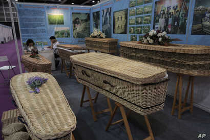 Wicker and seagrass coffins are displayed at the Asia Funeral and Cemetery Expo & Conference in Hong Kong, May 18, 2017. The expo underscores how for some investors Asia's rapidly aging population makes its death industry a potentially lucrative mark...
