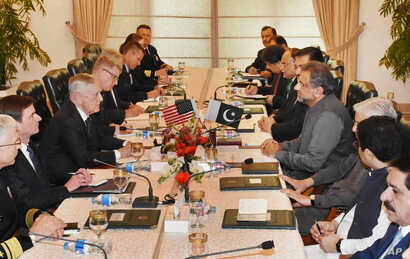 U.S. Defense Secretary Jim Mattis, third left, meets with Pakistani Prime Minister Shahid Khaqan Abbasi, fourth right, in Islamabad, Pakistan, Dec. 4, 2017.