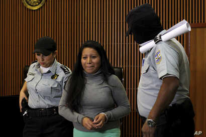 Teodora Vasquez, found guilty of what the court said was an illegal abortion via induced miscarriage, arrives in a courtroom to appeal her 30-year prison sentence, in San Salvador, El Salvador, Dec. 13, 2017.