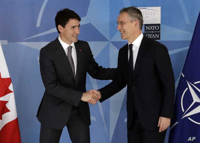 Canadian Prime Minister Justin Trudeau, left, shakes hands with NATO Secretary General Jens Stoltenberg at NATO headquarters in Brussels, Belgium, May 25, 2017.