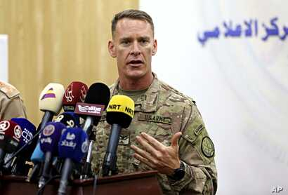 U.S. Army Colonel Ryan Dillon, spokesman for Operation Inherent Resolve, the U.S.-led coalition against the Islamic State group, speaks during a press conference in Baghdad, Iraq, Aug. 24, 2017.
