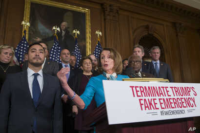 House Speaker Nancy Pelosi of California, accompanied by Rep. Joaquin Castro, D-Texas, left, and others, speaks about a resolution to block President Donald Trump's emergency border security declaration on Capitol Hill, Feb. 25, 2019, in Washington. ...