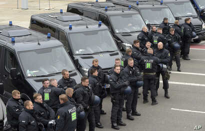 Police officers prepare for a rally in Chemnitz, eastern Germany, Sept. 1, 2018.