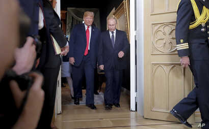 U.S. President Donald Trump, left, and Russian President Vladimir Putin arrive for a one-on-one-meeting at the Presidential Palace in Helsinki, Finland, July 16, 2018.