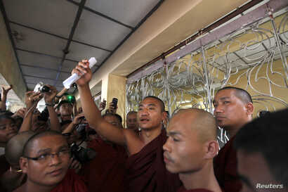 FILE - Gambira talks to supporters at the court hearing of Pyi Nyar Thiha, the head of Shwenyawar monastery, in this January 2012 photo.