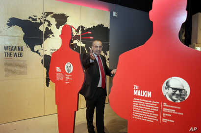 "Avner Avraham, former Israeli Mossad agent and curator of ""Operation Finale: The Capture & Trial of Adolf Eichmann,"" stands among silhouette cutouts of the 11 agents who caught Eichmann in Argentina, in the exhibit at the Museum of Jewish Heritage, i..."