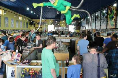 Clients comb through comic books at Heroes Aren't Hard to Find in Charlotte, North Carolina