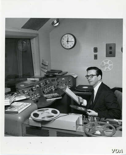 Voice of America radio DJ Willis Conover in his booth. Credit: Courtesy of the Willis Conover Collection, University of North Texas Music Library