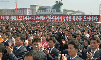 FILE - North Koreans clap during a rally at the Kim Il Sung Square in Pyongyang, April 10, 2014. North Korea held the rally to celebrate the re-election of its leader Kim Jong Un as First Chairman of the ruling National Defense Commission.
