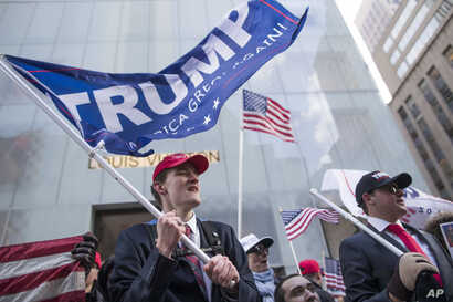 President Donald Trump supporters Tristan Pitera, left, and Jesse Michaelson of Sound Beach, N.Y., take part in a March 4 Trump rally on Fifth Avenue near Trump Tower in New York, March 4, 2017.