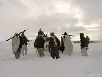 In this picture released exclusively to Reuters Jan. 17, 2009, Taliban militants are seen with their weapons in an undisclosed location in Afghanistan. With recents attacks, the group has been defying a longstanding practice of 'winter lull,' 'spring...