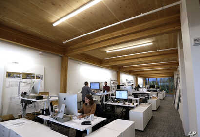 An upper floor of Lever Architecture headquarters, a four-story all-wood building built using cross-laminated timber stands in Portland, Ore., Nov. 15, 2016.