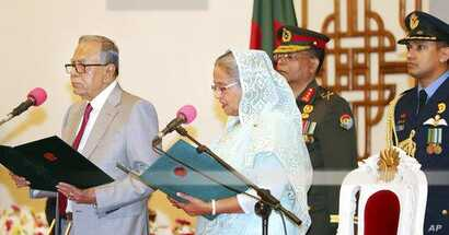 FILE - Bangladeshi President M. Abdul Hamid administers the oath of office to Prime Minister-elect Sheikh Hasina in Dhaka, Bangladesh, Jan. 7, 2019. The new government is Hasina's third in a row and fourth overall.