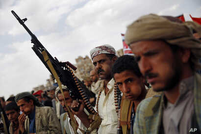 A Shiite Houthi rebel holds his weapon as he attends a rally to protest Saudi-led airstrikes, in Sanaa, Yemen, Monday, Aug. 24, 2015.