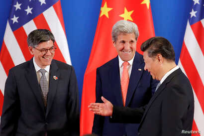 China's President Xi Jinping, right, meets with U.S. Secretary of State John Kerry, center, and U.S. Treasury Secretary Jack Lew during the joint opening ceremony of the 8th round of U.S.-China Strategic and Economic Dialogues, in Beijing, June 6, 20...