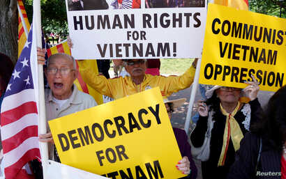 FILE - Vietnamese Americans protest outside the White House before U.S. President Donald Trump's meeting with Vietnamese Prime Minister Nguyen Xuan Phuc at the White House in Washington.