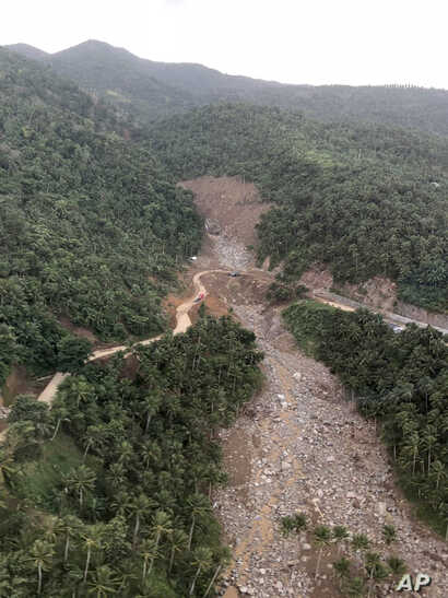 An aerial view of one of several landslides in Camarines Sur province in the Bicol region south of the main island of Luzon, is seen as President Rodrigo Duterte conducts an inspection, Jan. 4, 2019,