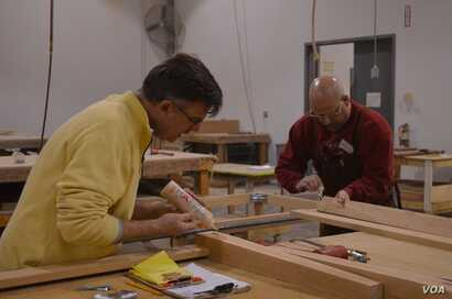 Mark Gatterdam, one of six partners, all craftsmen, who own and operate Hardwood Artisans, works with a customer. (Photo by Erin Gallagher)